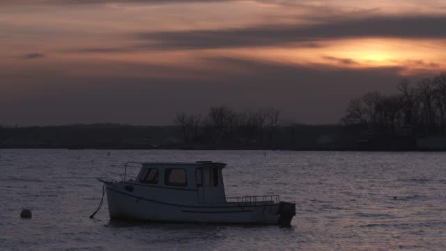 vídeos y material grabado en eventos de stock de boat on mooring with sunset 2 - vector