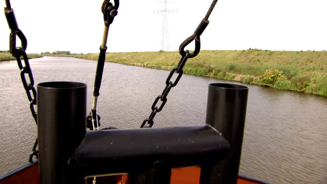boat on river in a polder, the netherlands - polder stock videos and b-roll footage