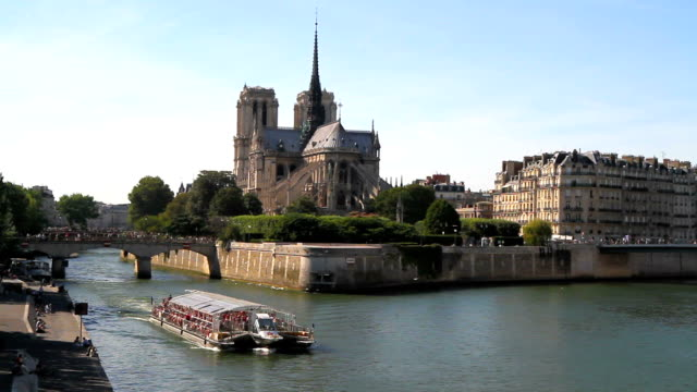boat on seine river in paris - notre dame de paris stock videos and b-roll footage