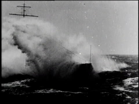 boat on stormy sea / bow of ship crashing through wave / man looking at sea with binoculars / waves crash on floating dock / man holding onto rope /... - d day stock videos & royalty-free footage