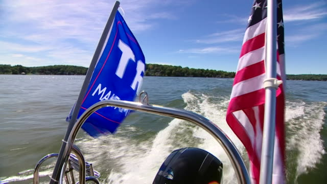 boat parade put on by donald trump and republican supporters on lake hopatcong in new jersey, usa and trump flags - nautical vessel stock videos & royalty-free footage