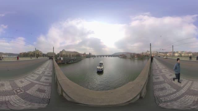 vídeos de stock e filmes b-roll de boat passes under mánes bridge in prague. - ponte carlos