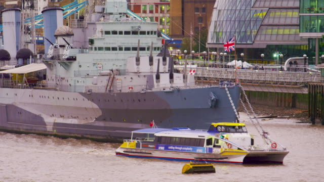 Boat passing a ship on river Thames