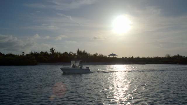 Boat passing by at sun down / Parrot Cay, Turks and Caicos