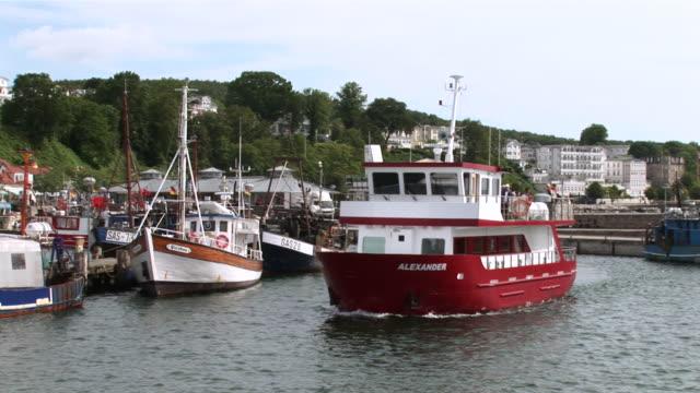 ws boat passing by in port of sassnitz on rã¼gen island  /sassnitz , mecklenburg-western pomerania, germany - komplett stock-videos und b-roll-filmmaterial