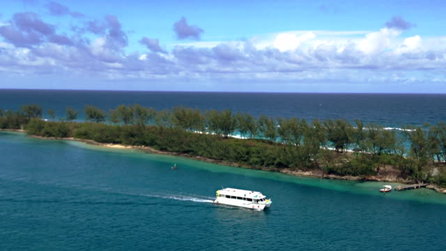 boat passing by tropical island - passenger craft stock videos & royalty-free footage
