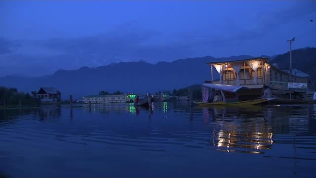 boat passing night shot dal lake srinagar jammu and kashmir india - dal bildbanksvideor och videomaterial från bakom kulisserna
