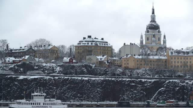 boat passing on a river / stockholm, sweden - stockholm stock videos & royalty-free footage