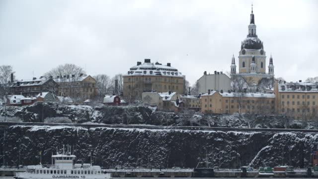 Boat passing on a river / Stockholm, Sweden