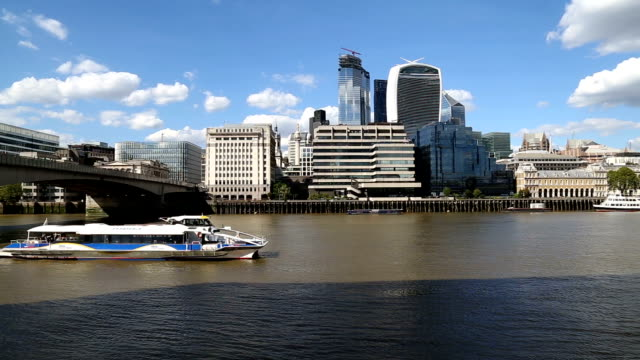 boat passing on thames river near london bridge and 20 fenchurch street is seen in the background - river thames stock videos & royalty-free footage