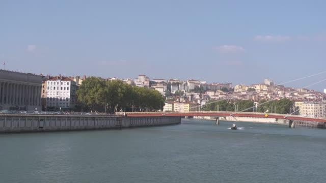 """boat passing on the river Saône, backround hill Croix Rousse and bridge """" La Passerelle du Palais de Justice"""""""