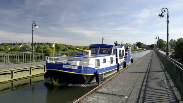 Boat passing over Briare Pont Canal on Canal Lateral, Loire River