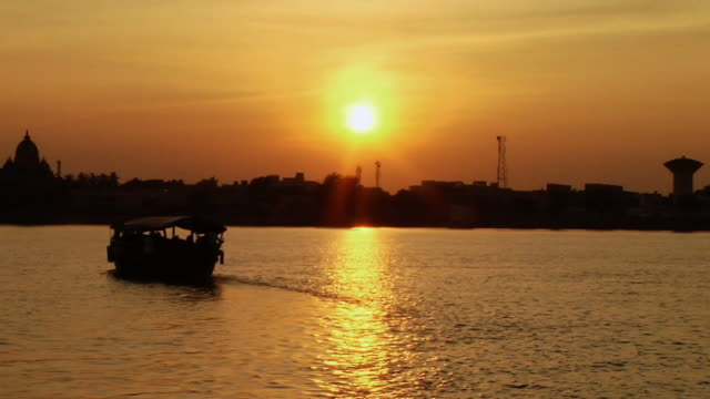 MS Boat passing through river at sunset  / Kolkata, West Bengal, India