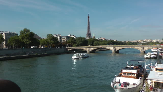 boat passing through river seine in paris, france - ausflugsboot stock-videos und b-roll-filmmaterial