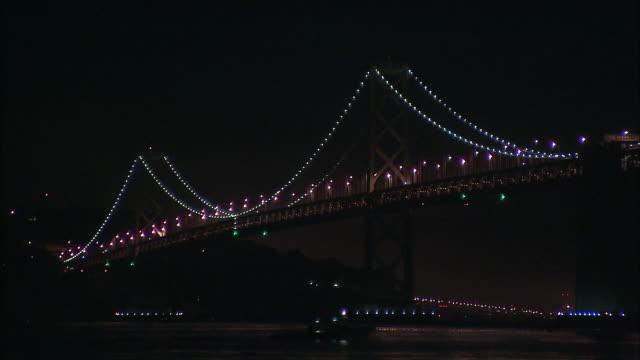 ms la boat passing under bay bridge at night, san francisco, california, usa - san francisco bay bridge stock videos and b-roll footage