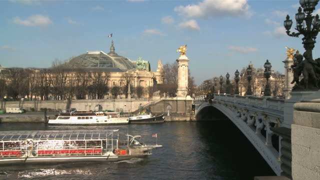 ws boat passing under pont alexandre iii bridge with grand palais in background / paris, ile de france, france - pont alexandre iii stock videos & royalty-free footage
