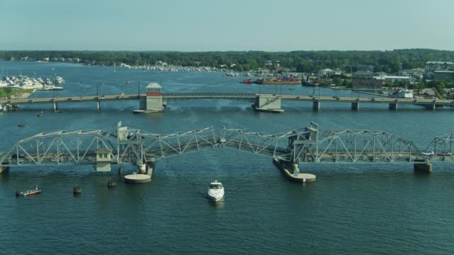 boat passing under sturgeon bay bridge - aerial - bascule bridge stock videos & royalty-free footage