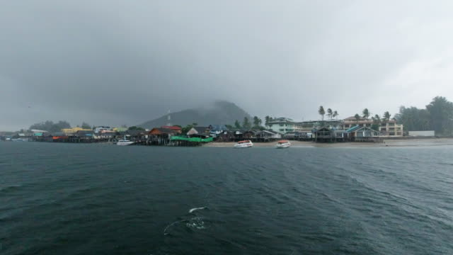 boat point of view journey on rainy day approaching thai fishing port - ko lanta stock videos & royalty-free footage