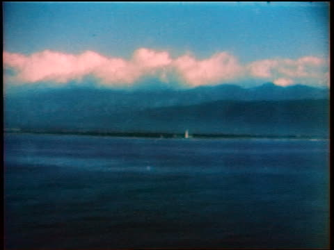 1936 boat point of view mountainous coastline with clouds / Jamaica