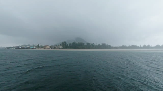 boat point of view ocean seascape during monsoon storm journey into land - ko lanta stock videos & royalty-free footage