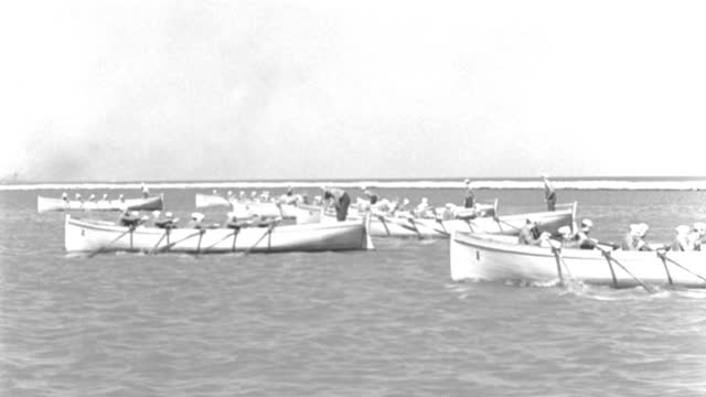 boat point of view of men rowing whaleboats in basin during boat race - 1944 stock videos & royalty-free footage