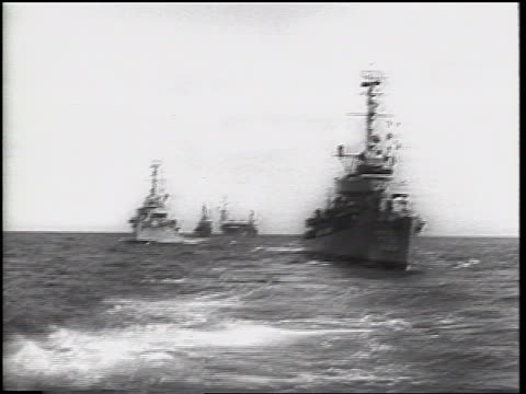 vídeos y material grabado en eventos de stock de rear boat point of view of military ships on ocean / cuban missile crisis / newsreel - 1962