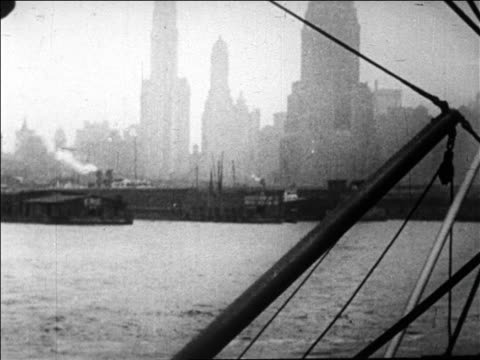 b/w 1926 boat point of view of new york city skyline as seen from harbor / newsreel - new york harbor stock videos & royalty-free footage