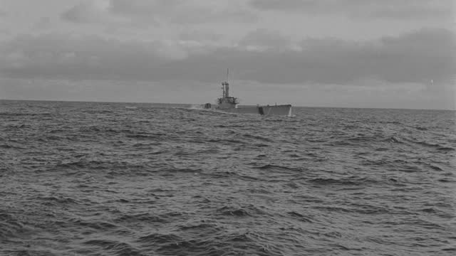 boat point of view of submarine emerging from sea during overcast evening - surfacing stock videos & royalty-free footage