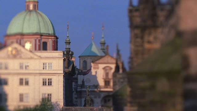 boat point of view pan on vltava river and under charles bridge / prague, czech republic - charles bridge stock videos and b-roll footage