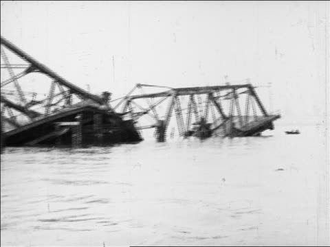 boat point of view past collapsed bridge in water / san francisco / slate at beginning / newsreel - 1926年点の映像素材/bロール