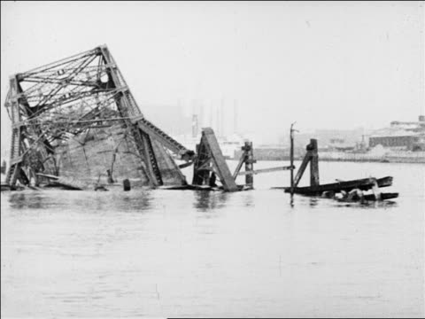 boat point of view past collapsed bridge in water / san francisco / slate at beginning / newsreel - 1926 stock videos & royalty-free footage
