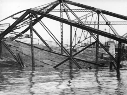 boat point of view past collapsed bridge + men in motorboats / san francisco / newsreel - 1926 stock videos & royalty-free footage