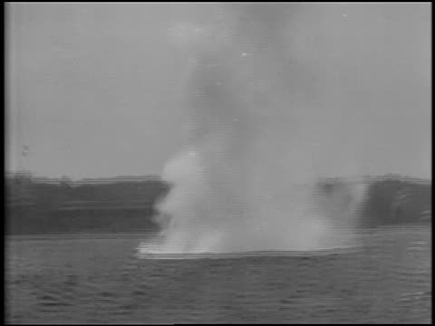 b/w 1929 boat point of view underwater mine exploding in ocean / coastline of portland, maine in background / newsreel - 1929 stock videos and b-roll footage