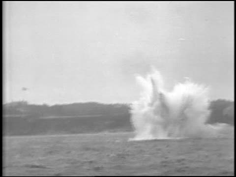 b/w 1929 boat point of view underwater mine exploding in ocean / portland, maine coastline in background / newsreel - 1929 stock videos and b-roll footage