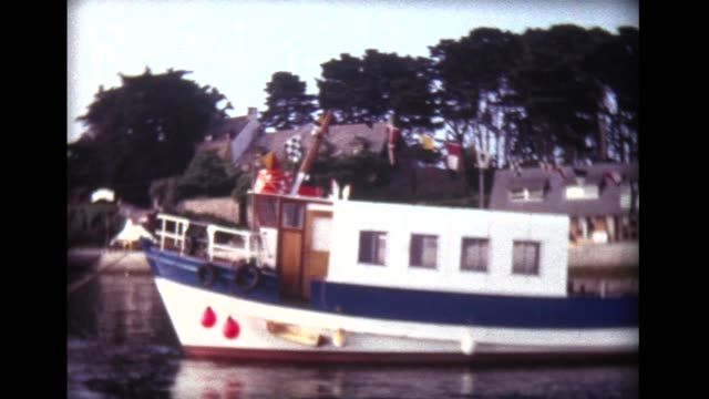 1973 boat pulling away from dock in Normandy, France