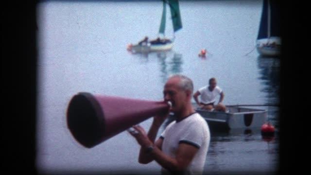 1966 boat race on lake, man uses megaphone - megaphone stock videos & royalty-free footage