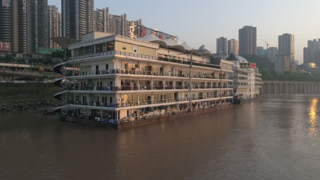 r/t ws ha boat restaurant on riverbank speeding ramp to city skyline / chongqing, china - ship's bridge stock videos & royalty-free footage