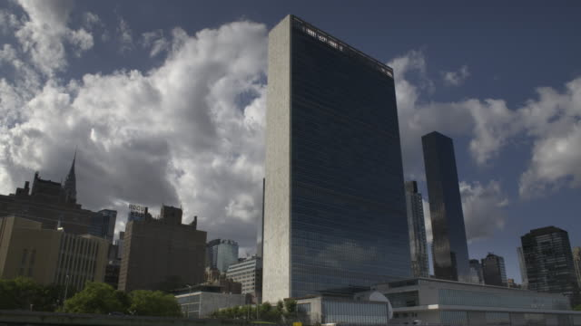 boat ride drifts past the un building - united nations building stock videos and b-roll footage