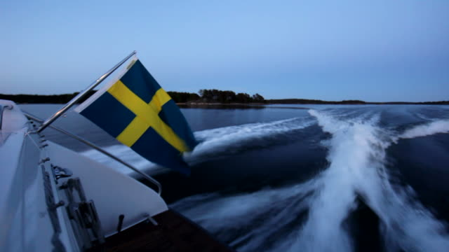 boat ride in archipelago of sweden - swedish flag stock videos and b-roll footage