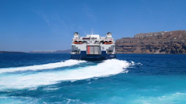 boat riding at aegean sea at santorini harbor, 4k resolution. - naxos greek islands stock videos & royalty-free footage