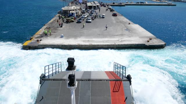 boat riding at aegean sea with naxos island greece, 4k resolution. - naxos greek islands stock videos & royalty-free footage