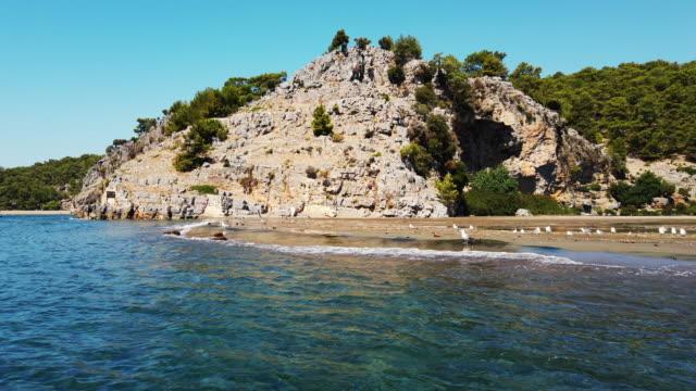 boat roving on iztuzu beach, dalyan - backwater stock videos & royalty-free footage