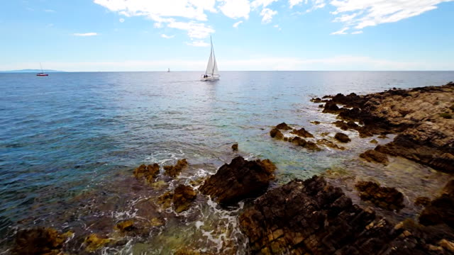 aerial boat sailing along a rocky coast - adriatic sea stock videos & royalty-free footage