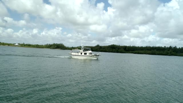 boat sailing along biscayne bay - biscayne bay stock videos & royalty-free footage