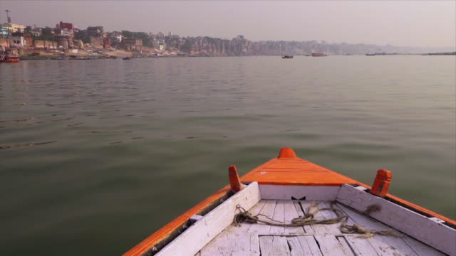 boat sailing along the sacred river ganga, india - push in stock videos & royalty-free footage