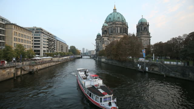 Boat sailing in the canal next to Museum island and Berliner dom (Berlin Cathedral), Berlin