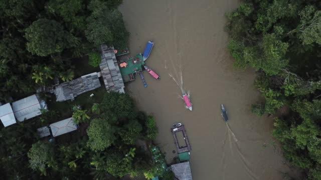 vídeos de stock, filmes e b-roll de boat sailing on the guamá river in belém, brazil - nautical vessel