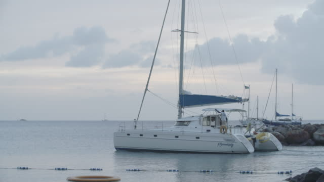 boat sailing out to sea / saint lucia, carribbean - st lucia stock videos & royalty-free footage