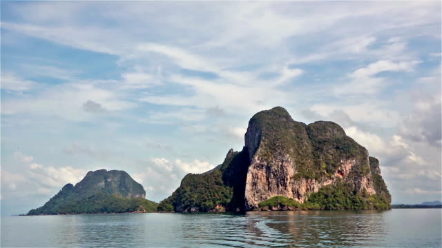 Boat sailing through the Trang islands in south Thailand