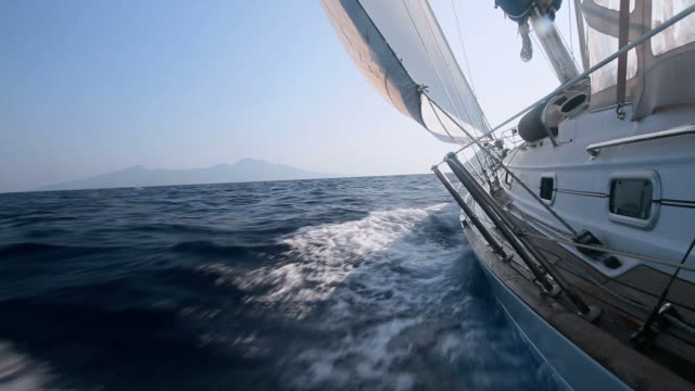 boat sailing through the waves with good wind - sailing ship stock videos & royalty-free footage